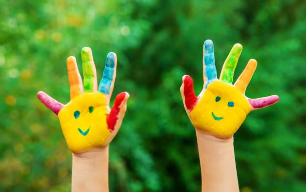 children-hands-colors-summer-photo-selective-focus_73944-497